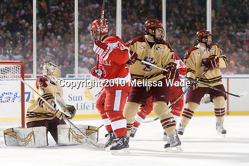 John Muse (BC - 1), Luke Popko (BU - 26), Tommy Cross (BC - 4) - The Boston University Terriers defeated the Boston College Eagles 3-2 on Friday, January 8, 2010, at Fenway Park in Boston, Massachusetts, as part of the Sun Life Frozen Fenway doubleheader.