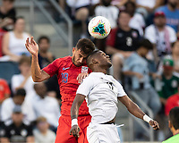 KANSAS CITY, KS - JUNE 26: Matt Miazga #19 and Armando Cooper #11 challenge for a header during a game between United States and Panama at Children's Mercy Park on June 26, 2019 in Kansas City, Kansas.