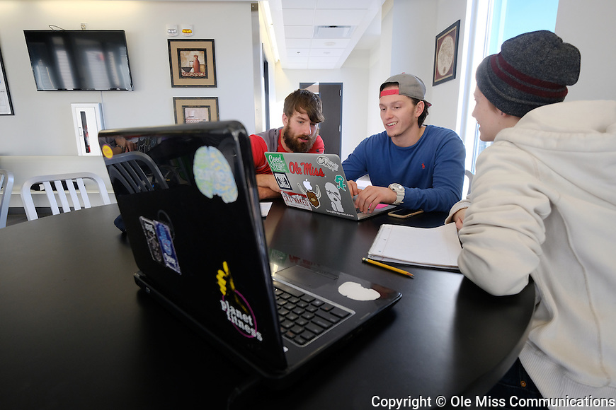 Students team up on their Mechanics of Materials course work in the civil engineering student lounge. Photo by Robert Jordan/Ole Miss Communications
