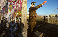'GDR border guard still defending a gap in the wall' - Berlin Wall west zone.10 November 1989