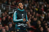 Pierre-Emerick Aubameyang of Arsenal, named as substitute, smiles as the Arsenal fans sing his name as he warms up in the first half during Arsenal vs Standard Liege, UEFA Europa League Football at the Emirates Stadium on 3rd October 2019
