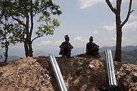 Two volunteers take rest in Sindhupalchok, outskirts of Kathmandu, Nepal. May 1, 2015