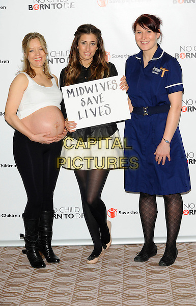 "STACEY SOLOMON .At the launch of Save The Children's ""Missing Midwives"" report, London, England, UK, 1st April 2011..full length black sheer see thru through shirt  cream white skirt tights ballet flats pregnant lady women sign slogan midwife nurse uniform  .CAP/CJ.©Chris Joseph/Capital Pictures."