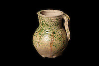 A terracotta pitcher with red painted decoration, a green and yellow lead glaze and small pinched feet, 12th century, from the excavations led by Sebastien Ziegler, from Fosse Depotoir F250, rue de la Madeleine, at the medieval castle of Chateau-Thierry, Picardy, France. The first fortifications on this spur over the river Marne date from the 4th century and the first castle was built in the 9th century Merovingian period by the counts of Vermandois. Thibaud II enlarged the castle in the 12th century and built the Tour Thibaud, and Thibaud IV expanded it significantly in the 13th century to include 17 defensive towers in the walls and an East and South gate. The castle was largely destroyed in the French Revolution after having been a royal palace since 1285. In 1814 it was used as a citadel for Napoleonic troops. Picture by Manuel Cohen