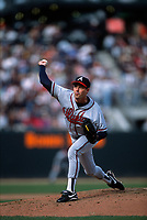 SAN FRANCISCO, CA:  Greg Maddux of the Atlanta Braves pitches during a game against the San Francisco Giants at Pacific Bell Park in San Francisco, California in 2000. (Photo by Brad Mangin)