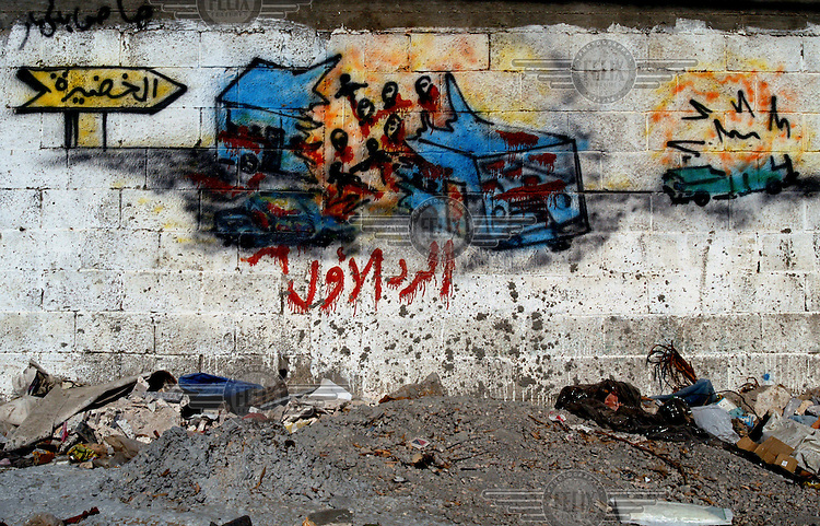 A grafitti picture on a wall in Gaza depicting a suicide car bomb attack on an Israeli bus.