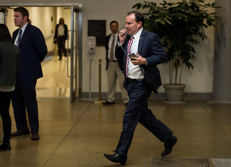 UNITED STATES - MAY 21: Sen. Mike Lee, R-Utah, runs back to the Senate office buildings form the Capitol after the Senate voted to cut off a filibuster of President Barack Obama's Trade Promotion Authority package on Thursday, May 21, 2015. (Photo By Bill Clark/CQ Roll Call)