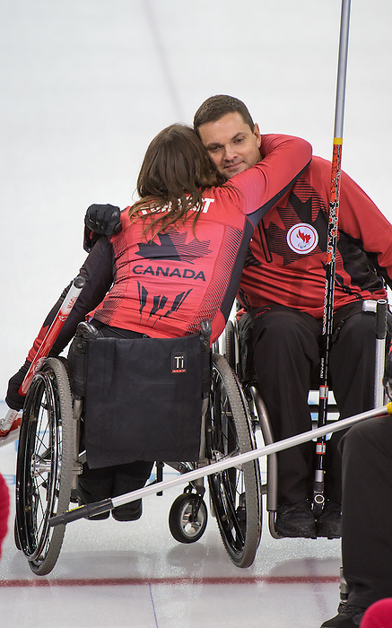 Sochi, RUSSIA - Mar 8 2014 -  Ina Forrest and Mark Ideson celebrates their victory over Russia during round robin play in Wheelchair Curling during the 2014 Paralympic Winter Games in Sochi, Russia.  (Photo: Matthew Murnaghan/Canadian Paralympic Committee)