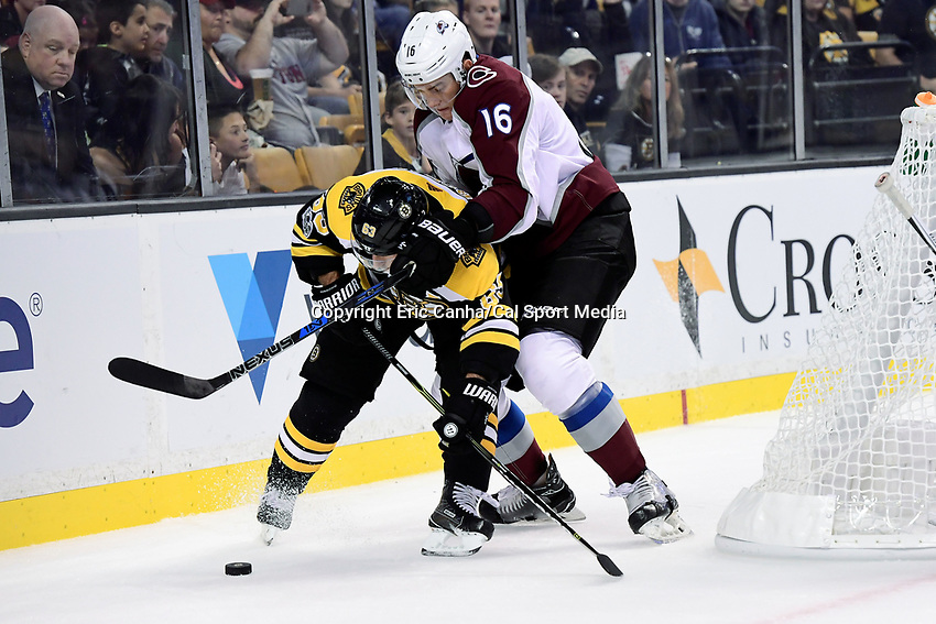 October 9, 2017: Colorado Avalanche defenseman Nikita Zadorov (16) battles to keep Boston Bruins left wing Brad Marchand (63) from the puck during the NHL game between the Colorado Avalanche and the Boston Bruins held at TD Garden, in Boston, Mass. Colorado defeats Boston 4-0. Eric Canha/CSM