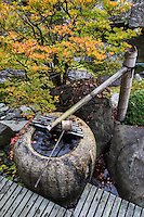 Water is considered purifying in Japan, hence the emphasis on cleanliness in everyday life. Water fountains such as these, known as tsukubai, are also beneficial to hear the trickling of falling water to soothe the nerves as well. A tsukubai is a small basin provided at Japanese Buddhist temples for visitors to purify themselves by the ritual washing of hands and rinsing of the mouth. This type of ritual cleansing is also the custom for guests attending a tea ceremony. Tsukubai are usually of stone, and are often provided with a small scoop, laid across the top, ready for use.