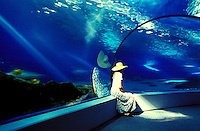 A woman enjoys the Maui Oceam Center aquarium at Maalaea Harbor. This was elected as Hawaii's number one tourist attraction by tourists.
