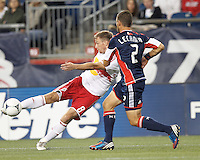 First half. New York Red Bulls defender Jan Gunnar Solli (8) takes a shot as New England Revolution defender Flo Lechner (2) defends. In a Major League Soccer (MLS) match, the New England Revolution vs New York Red Bulls, at Gillette Stadium on September 22, 2012.