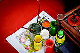VIETNAM, Hanoi, jars of colors and paintbrushes on a red carpet