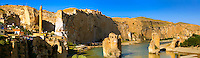 Remains of medieval Artukid Old Tigris Bridge – Built in 1116 by Artukid Fahrettin Karaaslan, the biggest in Anatolia at the time, with the old town Hasankeyf and its ruins on the cliffs abover the river Tigris. The minaret is of the El Rizk Mosque built 1409.  Turkey. 3