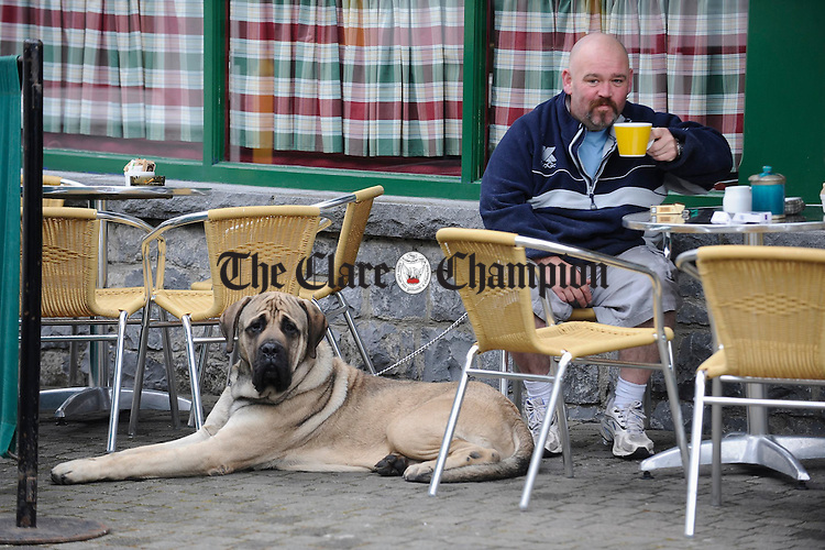 "Joe Chandler takes a break at Gerz cafe, Barrack St Ennis with his English Mastif ""House"". Photofraph by John Kelly."