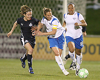 Sonia Bompastor #8 of the Washington Freedom is held off the ball by Kristine Lilly #13 of the Boston Breakers during a WPS match at the Maryland Soccerplex, in Boyd's, Maryland, on April 18 2009. Breakers won the match 3-1.
