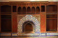 Berber Arabesque Zellige tile fireplace surround with painted wood panels.The Petite Court, Bahia Palace, Marrakesh, Morroco