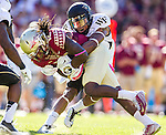 Wake Forest safety Anthony Wooding, Jr. brings down Seminole wide receiver Jarred Haggins after and 18 yard reception in the second quarter as Florida State defeated Wake Forest 43-3 in an NCAA football game in Tallahassee, FL October 4, 2014.