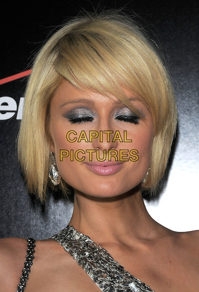 PARIS HILTON.The Verizon & Blackberry Storm Pre Grammy Party, Boulevard 3, Hollywood, California, USA..February 6th, 2009                                                                     headshot portrait silver one shoulder sequins sequined eyes closed blinking .CAP/DVS.©Debbie VanStory/Capital Pictures.