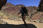 Man backpacking hiking the Bright Angel Trail along the Colorado River, Grand Canyon National Park, northern Arizona, USA . John offers private photo tours in Grand Canyon National Park and throughout Arizona, Utah and Colorado. Year-round.