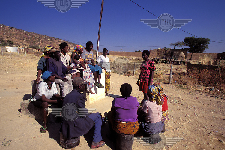 ©Giacomo Pirozzi/Panos Pictures..Angola. Comunity meeting for inhabitants of shanty settlement.
