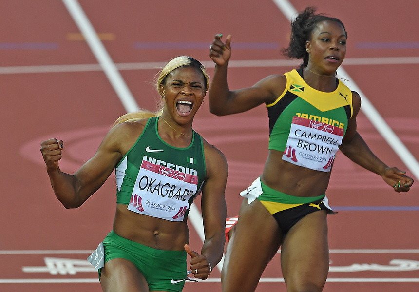 Blessing Okagbare (Nigeria), left, celebrates the women's 200m final ahead of Veronica Campbell-Brown (Jamaica)<br /> <br /> Photographer Chris Vaughan/CameraSport<br /> <br /> 20th Commonwealth Games - Day 5 - Monday 28th July 2014 - Athletics - Hampden Park - Glasgow - UK<br /> <br /> &copy; CameraSport - 43 Linden Ave. Countesthorpe. Leicester. England. LE8 5PG - Tel: +44 (0) 116 277 4147 - admin@camerasport.com - www.camerasport.com