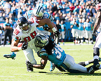 The Carolina Panthers defeated the Atlanta Falcons 34-10 in an inter-division rivalry played in Charlotte, NC at Bank of America Stadium.  Atlanta Falcons tight end Tony Gonzalez (88), Carolina Panthers strong safety Robert Lester (38)