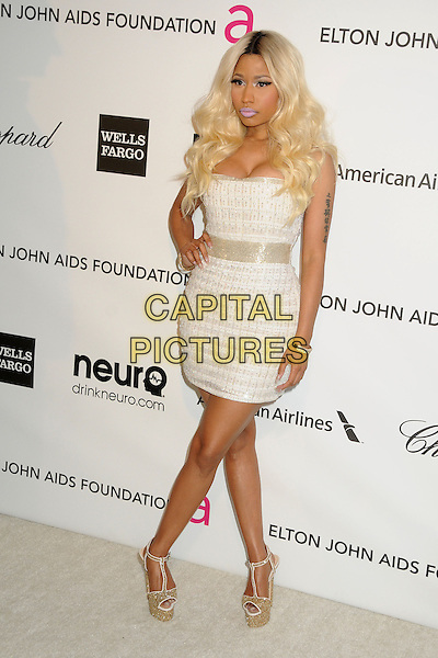 Nicki Minaj.21st Annual Elton John Academy Awards Viewing Party held at West Hollywood Park, West Hollywood, California, USA..February 24th, 2013.oscars full length silver white strapless dress cleavage gold shoes platform hand on hip tattoo.CAP/ADM/BP.©Byron Purvis/AdMedia/Capital Pictures.