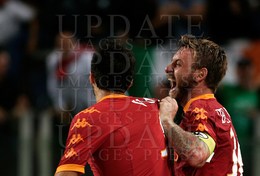 Calcio, Serie A: Roma-Inter. Roma, stadio Olimpico, 25 settembre 2010..Football, Italian serie A: AS Roma vs Inter Milan. Rome, Olympic stadium, 25 september 2010..AS Roma forward Mirko Vucinic, of Montenegro, left, is hugged by teammate Daniele De Rossi after scoring. AS Roma won 1-0..UPDATE IMAGES PRESS/Riccardo De Luca