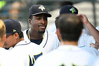 Starting pitcher Tony Dibrell (8) of the Columbia Fireflies is congratulated teammates during a game against the Charleston RiverDogs in which he set a Fireflies single-season strikeout record of 138 on Tuesday, August 28, 2018, at Spirit Communications Park in Columbia, South Carolina. Columbia won, 11-2. (Tom Priddy/Four Seam Images)