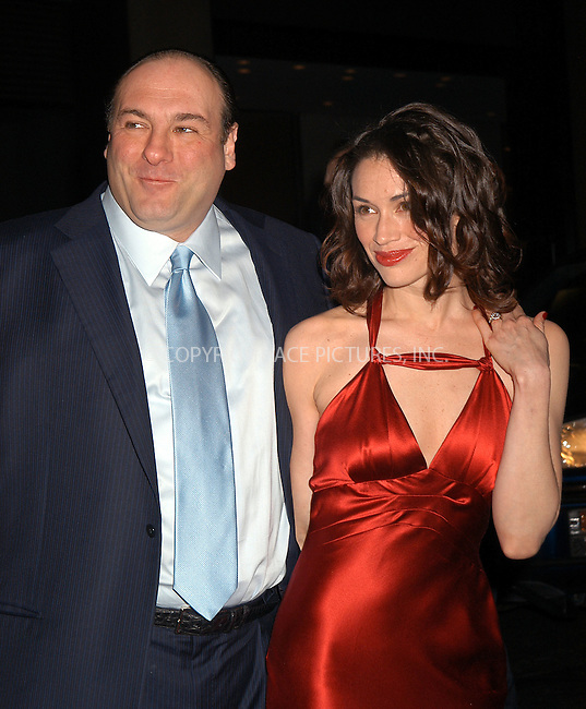 James Gandolfini and girlfriend Lora Somoza, who wears fantastic engagemnt diamond ring on her left arm, at the premiere of 'The Sopranos.' New York, March 2, 2004. Please byline: AJ SOKALNER/ACE Pictures.   ..*PAY-PER-USE*      ....IMPORTANT: Please note that our old trade name, NEW YORK PHOTO PRESS (NYPP), is replaced by new name, ACE PICTURES. New York Photo Press and ACE Pictures are owned by All Celebrity Entertainment, Inc.......All Celebrity Entertainment, Inc:  ..contact: Alecsey Boldeskul (646) 267-6913 ..Philip Vaughan (646) 769-0430..e-mail: info@nyphotopress.com