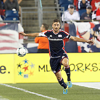 New England Revolution defender Chris Tierney (8) traps the ball. In a Major League Soccer (MLS) match, the New England Revolution (blue) defeated D.C. United (white), 2-1, at Gillette Stadium on September 21, 2013.