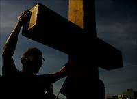 Neal Kennedy is holding the cross at the annual Walk the Cross in the town of Edmonton April 14, 2006. More than a thousand Edmontonian walked under the 2006 theme &quot;Make Poverty History&quot;<br />