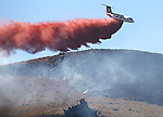 Firefighters from around the region fight a 200-300 acre brush fire in South Carson City, Nev., on Sunday, Aug. 14, 2016. The Shooting  Fire, which caused brief evacuations of the Carson Colony, was started by target shooters. <br /> Photo by Cathleen Allison