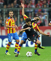 19.09.2012. Munich, Germany.  Munichs Jachallenger Martinez (front) and Jonas of Valencia vie for the ball during the UEFA Champions League group F soccer match between Bayern Munich and Valencia CF at the football  Arena M in Munich, Germany, 19 September 2012.
