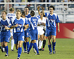 Birgit Prinz (9) is congratulated on her second goal of the game at SAS Stadium in Cary, North Carolina on 6/11/03 during a game between the Carolina Courage and Washington Freedom. Carolina won the game 3-0.