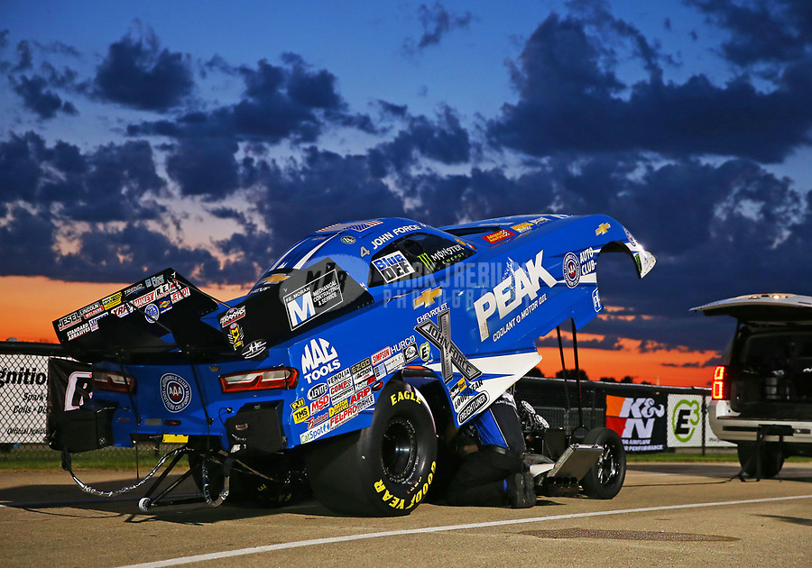 Jul 7, 2017; Joliet, IL, USA; The sun sets behind the car of NHRA funny car driver John Force during qualifying for the Route 66 Nationals at Route 66 Raceway. Mandatory Credit: Mark J. Rebilas-USA TODAY Sports