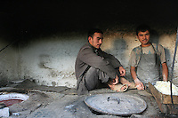 Uygur bakers cook in Hetian, Xinjiang province, China, on October 13, 2006. The Uyghur people are a Turkic ethnic group living mainly in the Xinjiang Uyghur Autonomous Region of China. Photo by Lucas Schifres/Pictobank