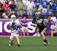 Steve Schoeffel (20) of Duke tries to pass the ball away from Kelly McKenna (13) of Notre Dame during the NCAA Men's Lacrosse Championship held at M&T Stadium in Baltimore, MD.  Duke defeated Notre Dame, 6-5, to win the title in overtime.
