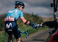 Jasha Sütterlin (DEU/Movistar) having his shoe fixed on the fly by the teamcar mechanic<br /> <br /> Racing in/around Lake District National Parc / Cumbria<br /> <br /> Stage 6: Barrow-in-Furness to Whinlatter Pass   (168km)<br /> 15th Ovo Energy Tour of Britain 2018