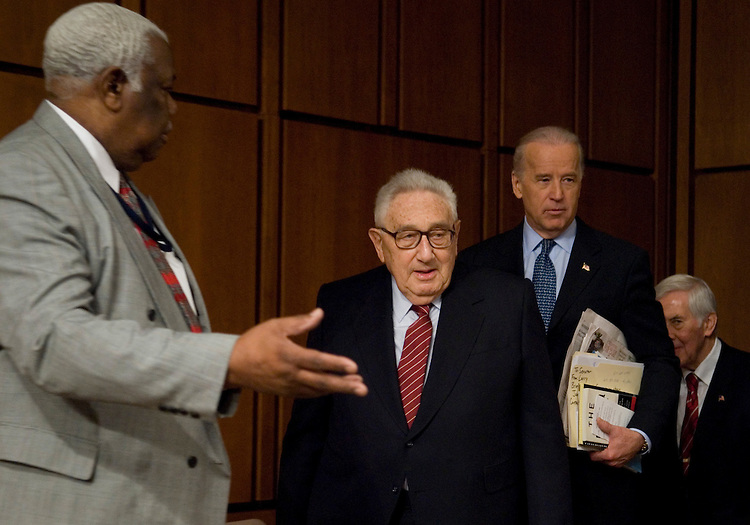 From left, former Secretary of State Henry Kissinger, committee chairman Joe Biden, D-Del., and Sen. Richard Lugar, R-Ind., arrive for the Senate Foreign Relations Committee hearing on securing America's interests in Iraq on Wednesday, Jan. 31, 2007.
