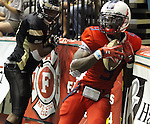 SIOUX FALLS, SD - JUNE 23:  James Terry #9 from the Sioux Falls Storm scores a touchdown past the defense from the Lee Valley Steelhawks in the first quarter of their first round playoff game Saturday night at the Sioux Falls Arena. (Photo by Dave Eggen/Inertia)