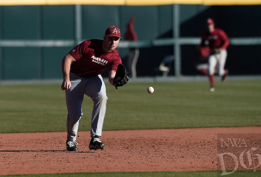 NWA Democrat-Gazette/MICHAEL WOODS @NWAMICHAELW<br /> University of Arkansas infielder Chad Spanberger makes the play on a ground ball Friday, January 27, during the Razorback baseball teams first practice for the 2017 season at Baum Stadium.