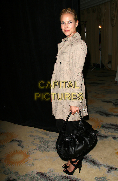 """MARIA BELLO.""""IWMF"""" International Women's Media Foundation Courage in Jounalism Awards held at the Beverly Hills Hotel, Beverly Hills, California, USA..October 16th, 2008.full length black shoes heels trousers bag beige coat.CAP/ADM/KB.©Kevan Brooks/AdMedia/Capital Pictures."""