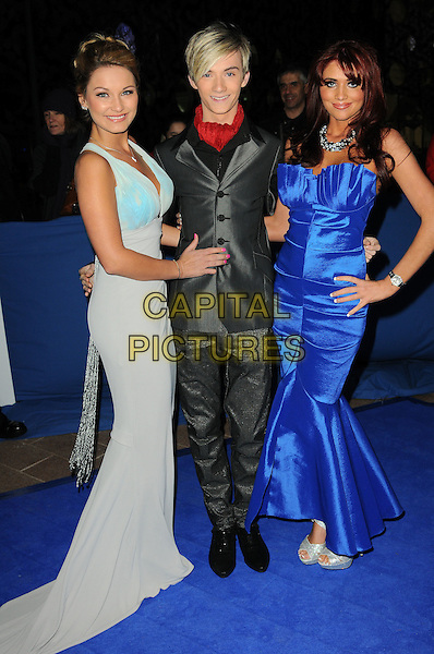 SAM FAIERS, HARRY DERBRIDGE & AMY CHILDS from 'The Only Way Is Essex' .Attending the British Comedy Awards 2011 at Indigo, The O2 Arena, London.England, UK, January 22nd, 2011..arrivals full length blue long maxi dress hand on hip grey gray suit red scarf black shirt strapless .CAP/CAS.©Bob Cass/Capital Pictures.