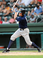 Infielder Garrison Lassiter (6) of the Charleston RiverDogs, Class A affiliate of the New York Yankees, in a game against the Greenville Drive on July 31, 2011, at Fluor Field at the West End in Greenville, South Carolina. (Tom Priddy/Four Seam Images)