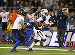 Nevada's Hasaan Henderson (12) runs against Boise State defender Joe Martarano (7) during the first half of an NCAA college football game in Reno, Nev., on Saturday, Oct. 4, 2014. Boise State won 51-46. (AP Photo/Cathleen Allison)