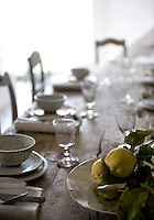 A large wooden table in the dining room has been made to measure and the Scandanvian chairs date from the 19th century