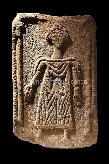 Portrait from a Roman stone tombstone of an unknown wealthy female, thought to be 3rd century AD, but reused in repairs to the 4th century fort wall, in the Vindolanda Museum, Hadrian's Wall, Northumberland, England. The Roman stonemason has produced an unflattering image of the deceased. Fragments of other female tombstones have also been found at Vindolanda. Hadrian's Wall was built 73 miles across Britannia, now England, 122-128 AD, under the reign of Emperor Hadrian, ruled 117-138, to mark the Northern extent of the Roman Empire and guard against barbarian attacks from the Picts to the North. The Vindolanda Museum is run by the Vindolanda Charitable Trust and forms part of the Hadrian's Wall UNESCO World Heritage Site. Picture by Manuel Cohen