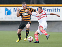 Alloa's Mark Docherty and Stirling's Phil Johnston challenge for the ball.